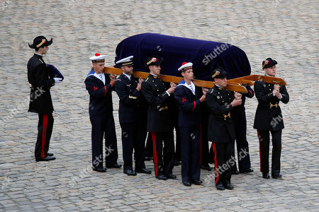 Stock Image of French Republican Guards and cadets from the joint-army military school (Ecole Militaire Interarmes, EMIA carry the coffin of late Serge Dassault, Chairman and CEO of Dassault Group during the funeral ceremony at Hotel des Invalides in Paris, France, . French business executive Serge Dassault, a top aviation and arms industrialist, has died in his Paris office. He was 93