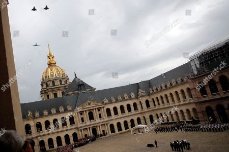 Two Rafales fighting jets and a Falcon business jet fly above the Hotel des Invalides courtyard with the coffin of late Serge Dassault, Chairman and CEO of Dassault Group during the funeral ceremony at Hotel des Invalides in Paris, France, . French business executive Serge Dassault, a top aviation and arms industrialist, has died in his Paris office. He was 93