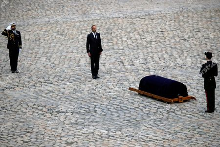 French Prime Minister Edouard Philippe, center left, stands in front of the coffin of late Serge Dassault, Chairman and CEO of Dassault Group during the funeral ceremony at Hotel des Invalides in Paris, France, . French business executive Serge Dassault, a top aviation and arms industrialist, has died in his Paris office. He was 93