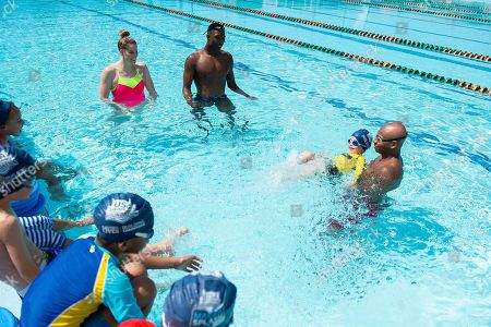 A class of children are taught to swim by USA Swimming Foundation ambassadors and Olympic gold medalists Missy Franklin and Cullen Jones along with Sports Illustrated Sports Kid of the Year, Reece Whitley as part of USA Swimming Foundation's Make a Splash initiative on in Washington, DC