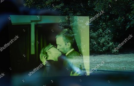A screen shows a film of homosexual couples kissing, part of a memorial designed by Michael Elmgreen and Ingar Dragset opposite the Holocaust Memorial at the Tiergarten in Berlin, Germany, 01 June 2018. Through the small square window the spectator can see a film depicting a kiss serving as a memorial to the homosexual victims of National Socialism and as a lasting symbol against exclusion, intolerance and animosity towards gays and lesbians.