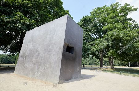 Stock Photo of An exterior view of the memorial designed by Michael Elmgreen and Ingar Dragset in the opposite the Holocaust Memorial at the Tiergarten in Berlin, Germany, 01 June 2018. Through the small square window the spectator can see a film depicting a kiss serving as a memorial to the homosexual victims of National Socialism and as a lasting symbol against exclusion, intolerance and animosity towards gays and lesbians.