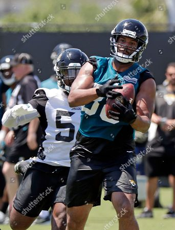Austin Seferian-Jenkins, Blair Brown. Jacksonville Jaguars tight end Austin Seferian-Jenkins (88) catches a pass in front of linebacker Blair Brown during an NFL football practice, in Jacksonville, Fla