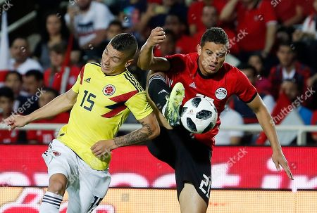 Colombia's Mateus Uribe, left, challenges for the ball with Egypt's Saad Samir during a friendly soccer match between Egypt and Colombia in Bergamo, Italy
