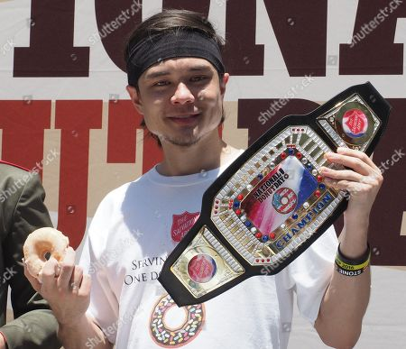 Matt Stonie celebrates after eating 48 donuts to win the  2nd Annual National Donut Day World Donut Eating Championship in Hollywood, California, USA, 01 June 2018.  The competition is sponsored by the Salvation Army and is part of its fundraising challenge to benefit veterans. Stonie fell short of the 55 donuts eaten in 8 minutes world record.