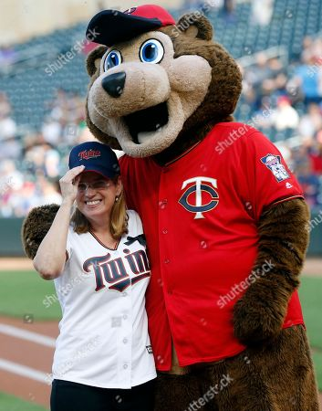 Carmen Julin Cruz. Carmen Yulin Cruz, left, mayor of San Juan, Puerto Roci, poses for a photo with TC Bear, the Minnesota Twins' mascot, after she threw to him a ceremonial first pitch before a baseball game between the Twins and the Cleveland Indians, in Minneapolis