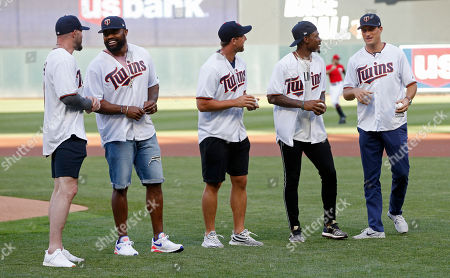 Harrison Smith, Everson Griffen, Adam Thielen, Stefon Diggs, Kirk Cousins. Minnesota Vikings NFL football players, from left, safety Harrison Smith, defensive end Everson Griffen, wide receiver Adam Thielen, wide receiver Stefon Diggs and quarterback Kirk Cousins, wait to take part in a ceremonial first pitch before the Minnesota Twins and Cleveland Indians baseball game, in Minneapolis. It was all part of Skol Night at Target Field