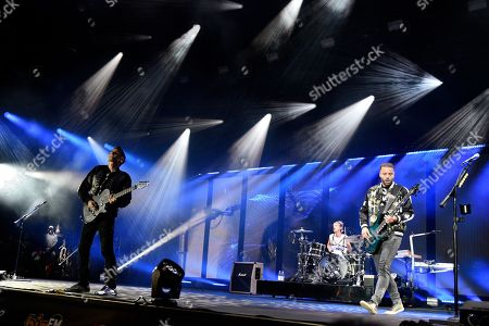 Matthew Bellamy, Dominic Howard and Christopher Wolstenholme
