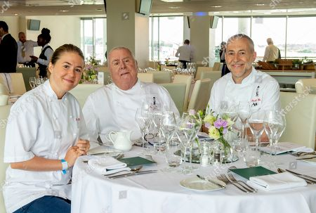 Stock Picture of Emily Roux, Albert Roux and Michel Roux Jnr. have a group photo in the Chez Roux restaurant ahead of service