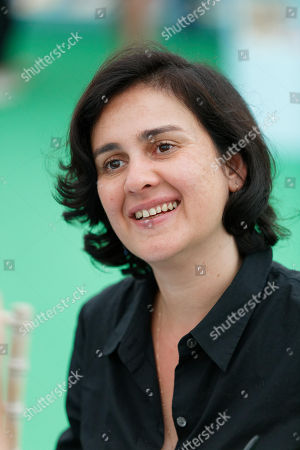 Stock Photo of Kamila Shamsie signs copies of her book