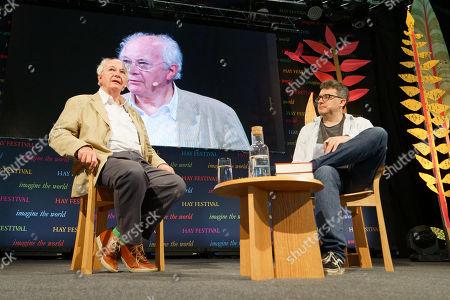 Novelist Philip Pullman (L) speaks to Daniel Hahn