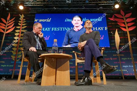 Stock Photo of Former MP David Miliband (R) talks to James Naughtie (L) in the Tata Tent