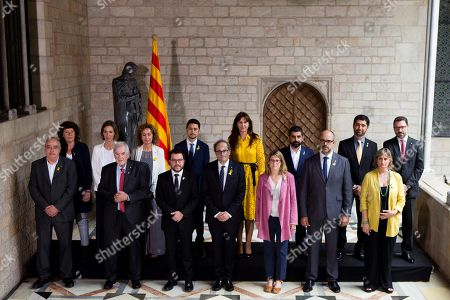 Catalan regional Government President, Quim Torra (C), poses next to members of his cabinet (1st row, L-R) Catalan regional Minister for Education, Josep Bargallo; Catalan regional Minister for Foreign Action, Ernest Maragall; Vice President of Catalonia and Counsellor of Economy and Finance, Pere Aragones; Catalan regional Presidency Minister and Spokesperson, Elsa Artadi; Catalan Home Minister, Miquel Buch; Catalan Health Minister,Alba Verges; (2nd row, L-R) Catalan Agriculture Minister, Teresa Jorda; Catalan Minister for Enterprise and Knowledge, Maria Angels Chacon; Catalan Justice Minister, Ester Capella; Catalan Minister for Territory and Sustainability, Damia Calvet; Catalan Culture Minister, Laura Borras; Catalan Labor, Social Affairs and Families Minister, Chakir El Homrani; Catalan Minister for Digital Policies and Public Administration, Jordi Puignero; and Secretary of the Govern, Victor Cullell; during the Catalan Government new consolers' swearing-in ceremony at Palau de la Generalitat in Barcelona, northeastern Spain, 02 June 2018.