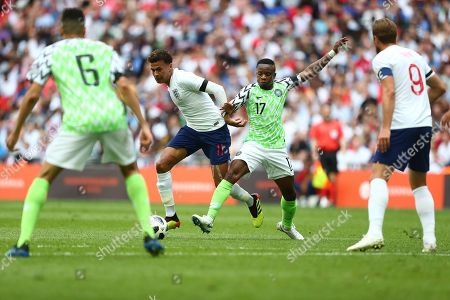 Stock Picture of Dele Alli of England battles with Ogenyi Onazi of Nigeria