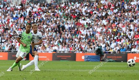 Harry Kane of England scores his sides second goal under pressure from William Troost-Ekong of Nigeria