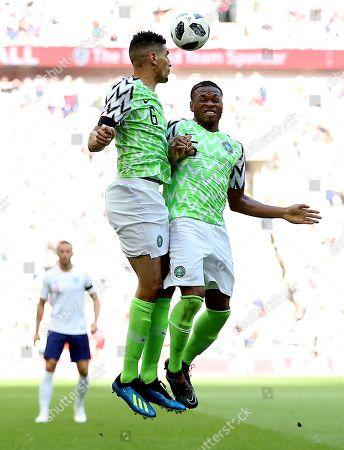Stock Picture of Leon Balogun of Nigeria and Joel Obi of Nigeria collide