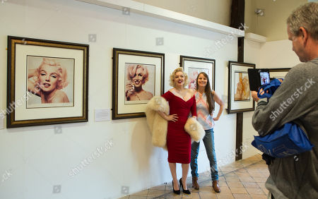 The world's leading Marilyn Monroe tribute artist, Suzie Kennedy poses for the public as she opens 'Timeless' exhibition at Moyses Hall, Bury St Edmunds