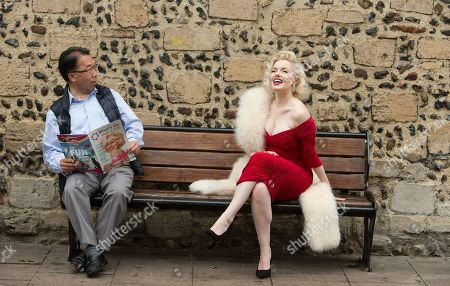 Stock Picture of Deputy Mayor Patcick Chung gasps as he realises he is seated beside the world's leading Marilyn Monroe tribute artist, Suzie Kennedy before she opened the 'Timeless' exhibition at Moyses Hall, Bury St Edmunds