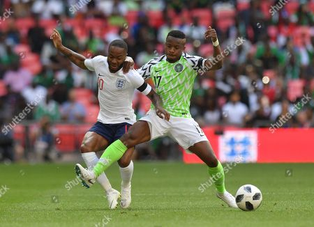 England's Raheem Sterling battles for possession with Nigeria's Ogenyi Onazi