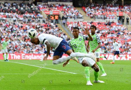 Ashley Young of England goes past Shehu Abdullahi of Nigeria