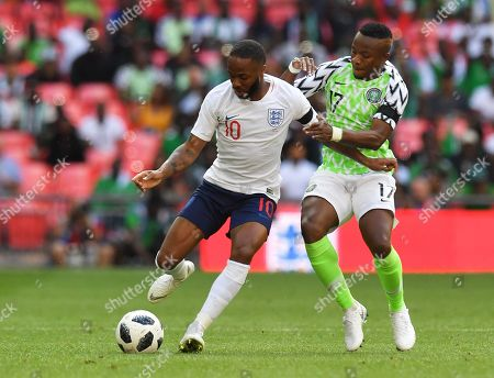 England's Raheem Sterling holds off the challenge from Nigeria's Ogenyi Onazi