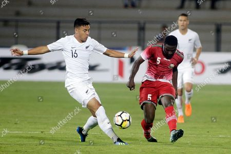 Kenya's soccer player Musa Mohammed Mayeko, right and New Zealand's Dane James Ingham vie for the ball during the Hero Intercontinental Cup match in Mumbai, India
