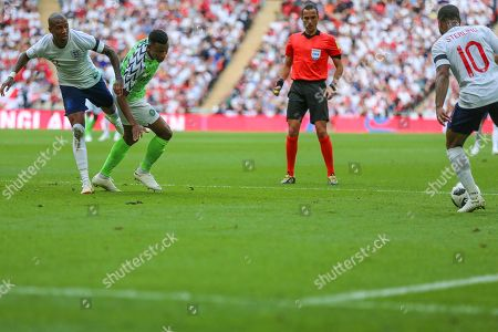England defender Ashley Young (3) clashes with Nigeria defender Shehu Abdullahi (12) during the Friendly International match between England and Nigeria at Wembley Stadium, London. Picture by Toyin Oshodi