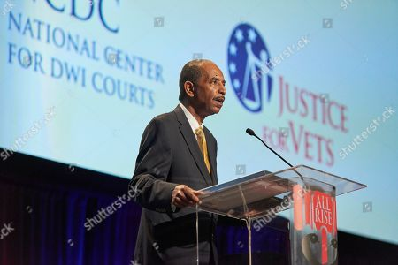 Judge Robert Russell, founder of the nation's first veterans treatment court in Buffalo, New York, celebrates the tenth anniversary of veterans treatment courts during the closing ceremony of the National Association of Drug Court Professionals annual training conference, in Houston
