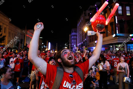 """Brian """"Buzz"""" Ganow, 22, of Manassas, Va., celebrates a goal in the second period of Game 3 of the NHL hockey Stanley Cup Final between the Washington Capitals and the Vegas Golden Knights, in Washington. Fans could watch the game on a large screen outside the venue. """"I've lived here my whole life,"""" says Ganow, """"so I've been waiting for this for a long time"""