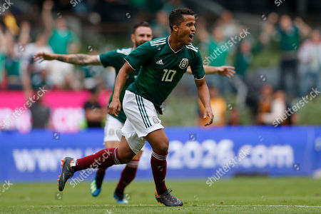 Mexico's Giovani dos Santos celebrates after scoring his side's first goal during a friendly soccer match against Scotland at Azteca Stadium in Mexico City
