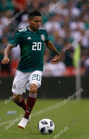Mexico's Javier Aquino controls the ball during a friendly soccer match between Mexico and Scotland at Azteca Stadium in Mexico City