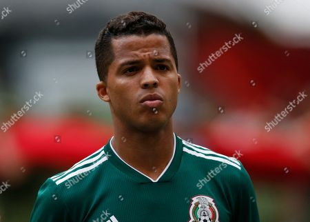Mexico's Giovani Dos Santos stands during the national anthems at the start of a friendly soccer match between Mexico and Scotland at Azteca Stadium in Mexico City
