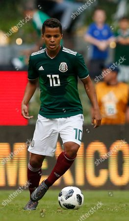 Mexico's Giovani Dos Santos controls the ball during a friendly soccer match between Mexico and Scotland at Azteca Stadium in Mexico City