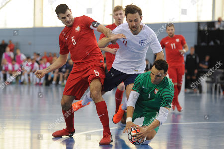 Stock Picture of Robert Gladczak and Michal Kaluza of Poland and Richard Ward of England during England vs Poland, International Futsal Friendly at St George's Park on 2nd June 2018