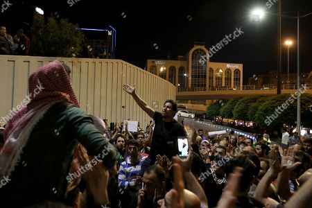 Jordanians shout slogans against the newly proposed income tax reforms and hike in petrol tax, in Amman, Jordan, 02 June 2018. The newly announced income taxes law has been prepared and sent to the parliament, and the protesters demand its withdrawal. The spokesman for the Jordanian professional associations and President of Jordan Doctor's Association Dr Ali Al Abous announced on 02 June a call for mobilization gathering to take place 06 June, one week after the first one, as its demands remained to be met.