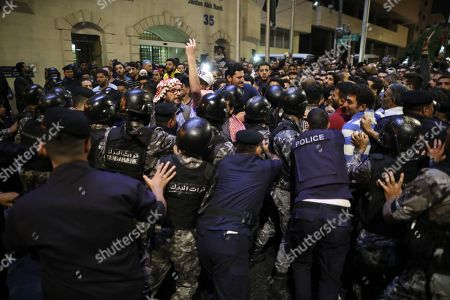 Jordanian security forces block protesters trying to get to the Prime Ministry, during a demonstration against the newly proposed income tax reforms and hike in petrol tax, in Amman, Jordan, 02 June 2018. The newly announced income taxes law has been prepared and sent to the parliament, and the protesters demand its withdrawal. The spokesman for the Jordanian professional associations and President of Jordan Doctor's Association Dr Ali Al Abous announced on 02 June a call for mobilization gathering to take place 06 June, one week after the first one, as its demands remained to be met.