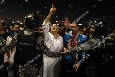 Jordanian security forces block protesters trying to get to the Prime Ministry, during a demonstration against the newly proposed income tax reforms and hike in petrol tax, in Amman, Jordan, 03 June 2018. The newly announced income taxes law has been prepared and sent to the parliament, and the protesters demand its withdrawal. The spokesman for the Jordanian professional associations and President of Jordan Doctor's Association Dr Ali Al Abous announced on 02 June a call for mobilization gathering to take place 06 June, one week after the first one, as its demands remained to be met.