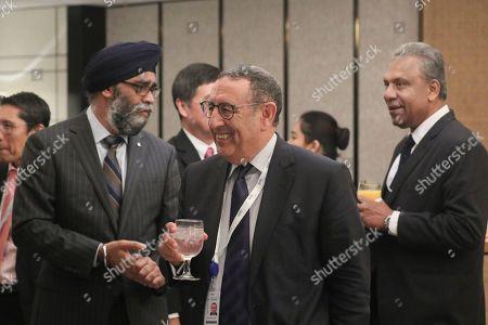 Youssef Amrani, Harjit Singh Sajjan and Kapila Waidyaratne