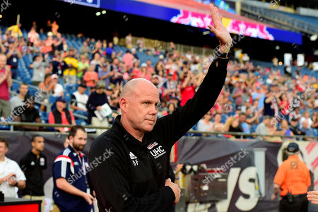 New England Revolution head coach Brad Friedel waves to fans at the MLS game between New York Red Bulls and the New England Revolution held at Gillette Stadium in Foxborough Massachusetts. The Revolution defeat the Red Bulls 2-1
