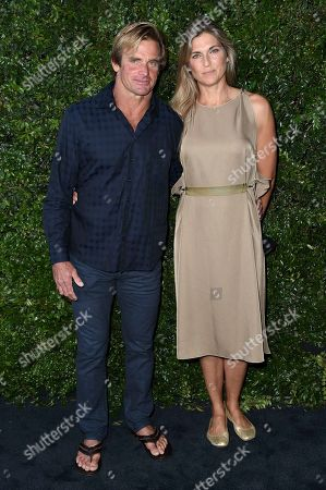 Laird Hamilton, Gabrielle Reece. Laird Hamilton, left, and Gabrielle Reece attend Chanel and NRDC Host Dinner to Celebrate Our Majestic Oceans, in Malibu, Calif