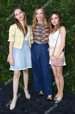 Iris Apatow, Leslie Mann, Maude Apatow. Iris Apatow, from left, Leslie Mann and Maude Apatow attend Chanel and NRDC Host Dinner to Celebrate Our Majestic Oceans, in Malibu, Calif