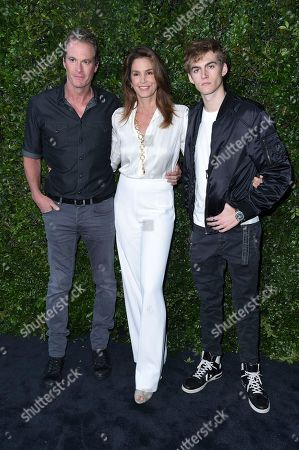Stock Picture of Rande Gerber, Cindy Crawford, Presley Walker Gerber. Rande Gerber, from left, Cindy Crawford and Presley Walker Gerber attend Chanel and NRDC Host Dinner to Celebrate Our Majestic Oceans, in Malibu, Calif