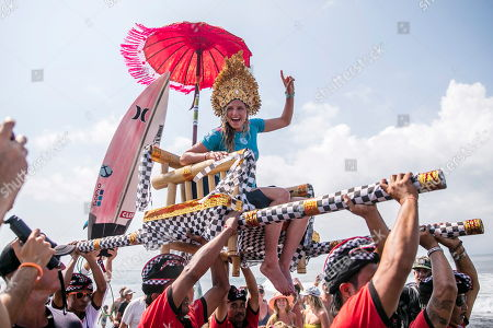 Stock Image of Lakey Peterson of the USA is celebrated after winning the Women's finals of the Corona Bali Protected surfing event as part of the World Surf League Championship Tour in Keramas, Bali, Indonesia, 03 June 2018.