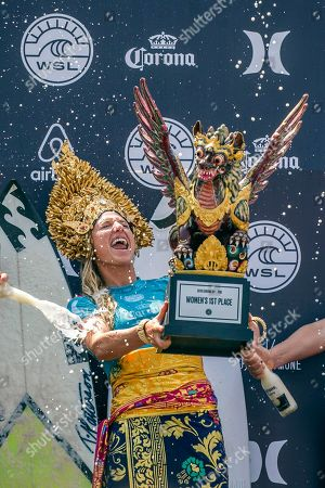 Lakey Peterson of the USA celebrates with the trophy on the podium after winning the Women's finals of the Corona Bali Protected surfing event as part of the World Surf League Championship Tour in Keramas, Bali, Indonesia, 03 June 2018.