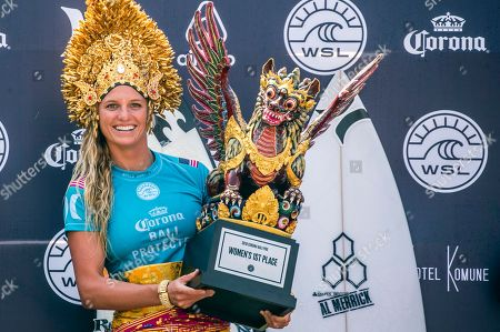 Stock Picture of Lakey Peterson of the USA celebrates with the trophy on the podium after winning the Women's finals of the Corona Bali Protected surfing event as part of the World Surf League Championship Tour in Keramas, Bali, Indonesia, 03 June 2018.