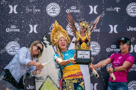 Lakey Peterson of the USA (C) celebrates with the trophy on the podium after winning the Women's finals of the Corona Bali Protected surfing event as part of the World Surf League Championship Tour in Keramas, Bali, Indonesia, 03 June 2018.