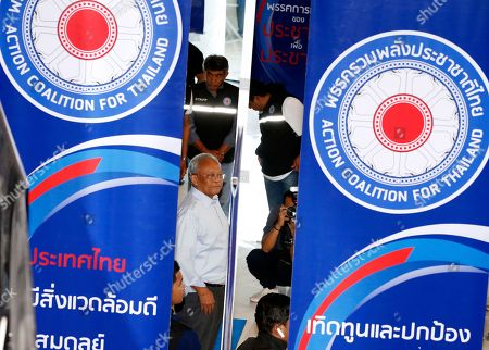 Stock Picture of Suthep Thaugsuban, Thai former protest leader of People's Democratic Reform Committee and former of Democrat Party secretary-general, (C) pose for photos between the logo of the Action Coalition for Thailand (ACT) party, before the first meeting at Rangsit University in Bangkok, Thailand, 03 June 2018. Suthep who is one of the co-founders of ACT party, as launch to the publicly in the meeting between the co-founders and supporters on 03 June.