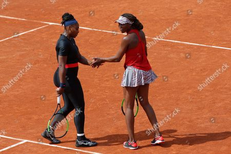 Serena Williams of the U.S., left, and her sister Venus Williams plays Slovenia's Andreja Klepac and Spain's Maria Jose Martinez Sanchez during their double match of the French Open tennis tournament at the Roland Garros stadium, in Paris