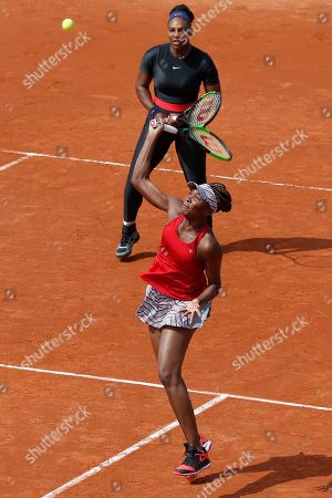 Serena Williams of the U.S., rear, and her sister Venus Williams plays Slovenia's Andreja Klepac and Spain's Maria Jose Martinez Sanchez during their double match of the French Open tennis tournament at the Roland Garros stadium, in Paris