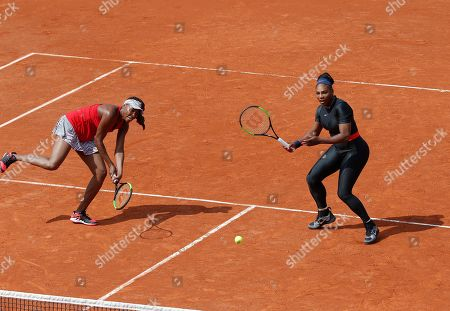 Serena Williams of the U.S., right, and her sister Venus Williams play Slovenia's Andreja Klepac and Spain's Maria Jose Martinez Sanchez during their double match of the French Open tennis tournament at the Roland Garros stadium, in Paris